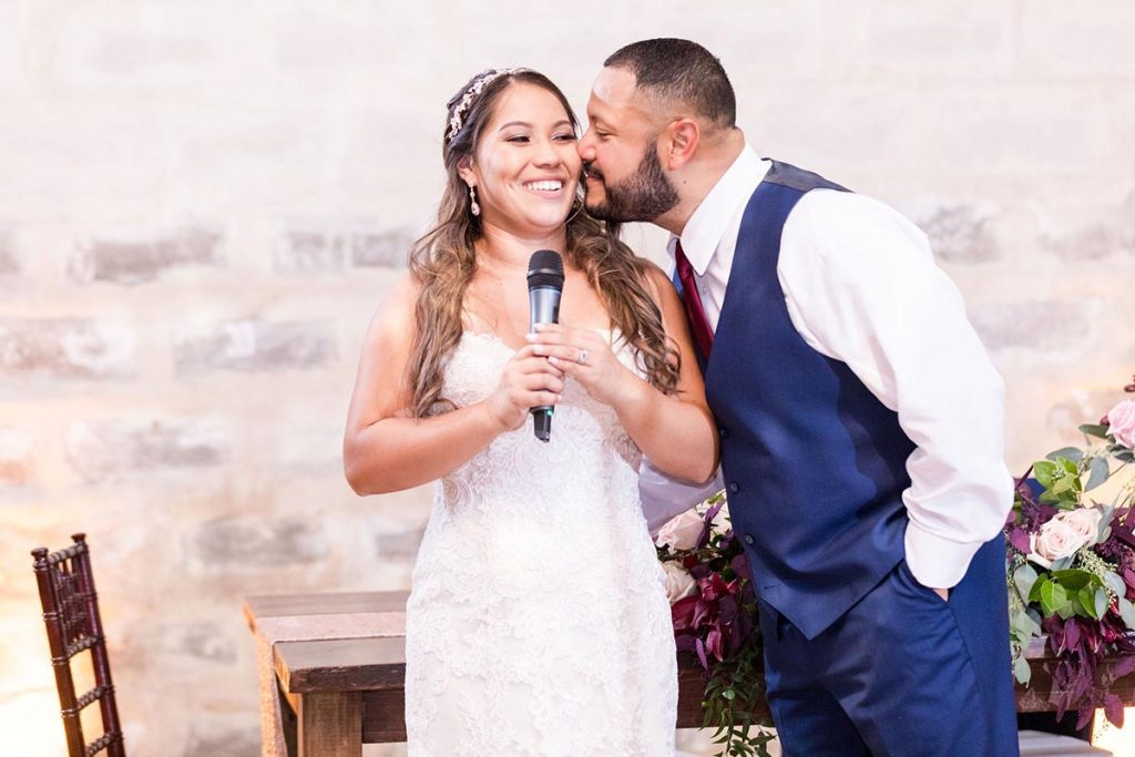 Edwin kissing Amanda on the cheek at their wedding