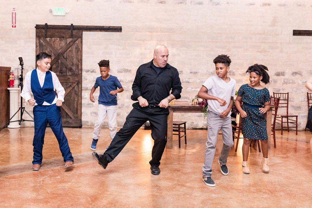San Antonio DJ dancing on the dance floor with kids