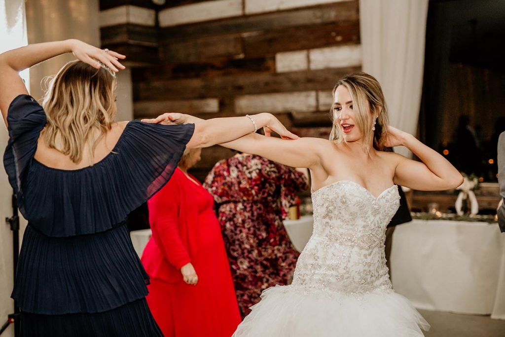 Nicole dancing with a friend at her wedding